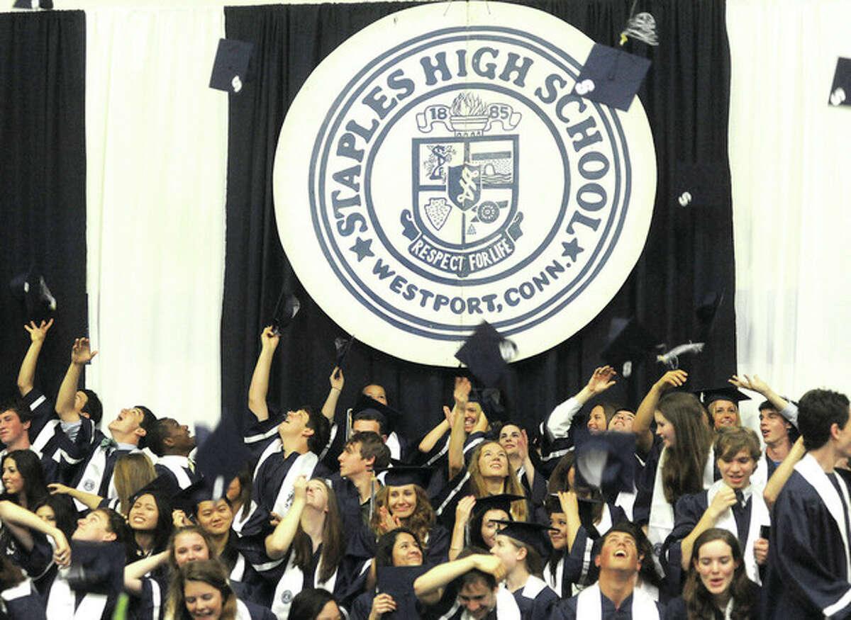 Hour photo / Matthew Vinci Staples High School's newest graduates celebrate Tuesday in Westport.