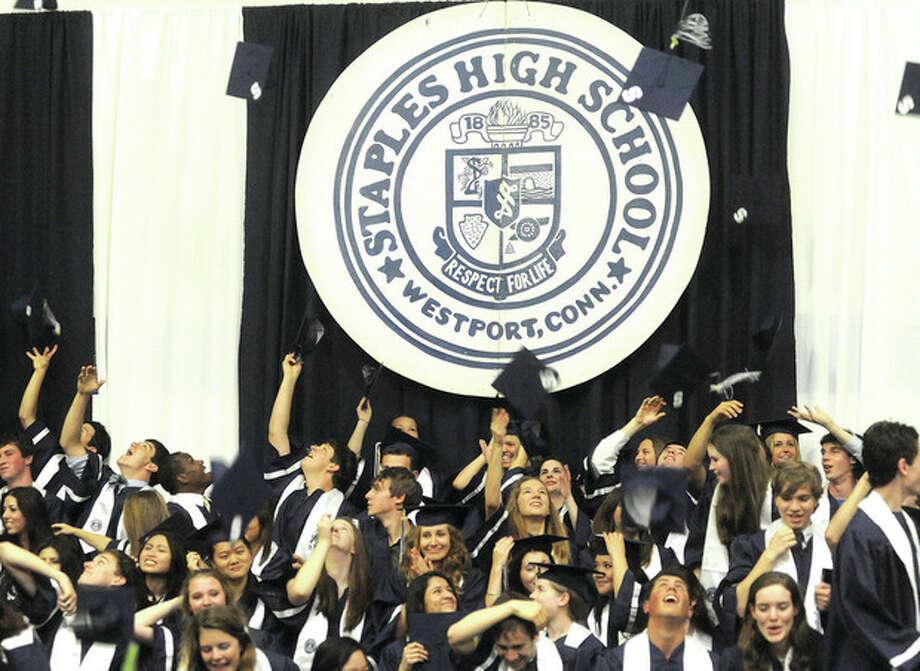 Hour photo / Matthew VinciStaples High School's newest graduates celebrate Tuesday in Westport.