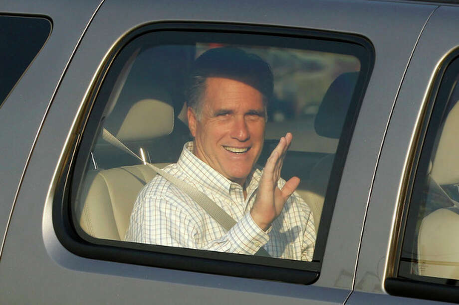 Republican Presidential candidate Mitt Romney waves as he arrives at the Utah Olympic Park for a private dinner during a donor's conference in Park City, Utah, Friday, June 22, 2012. (AP Photo/Charles Dharapak) / AP