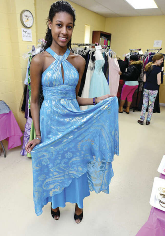 "Hour photo / Erik TrautmannProm readyNorwalk High School freshman Taila Roberson takes adavantage of the Christian Community Action and Person-to-Person annual ""Prom Dress Extravaganza"" Saturday. The dress giveaway benefits girls from low-to-moderate income families in Norwalk."