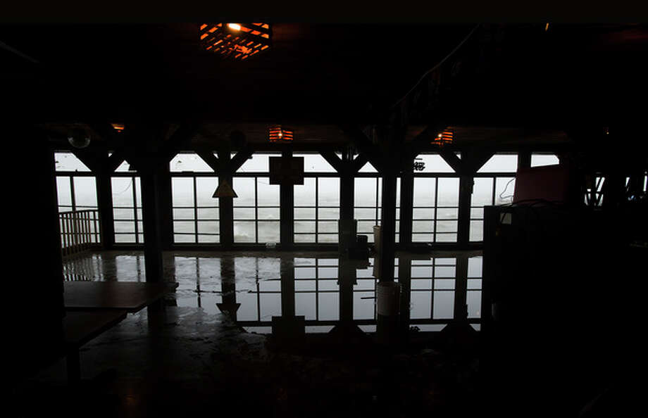 Water sneaks into a restaurant in Cedar Key, Fla. as Tropical Storm Debby churns on the Florida Gulf coast waiting to makes its way across the Gulf of Mexico early Sunday, June 24, 2012. (AP Photo/Phil Sandlin) / FR117487AP