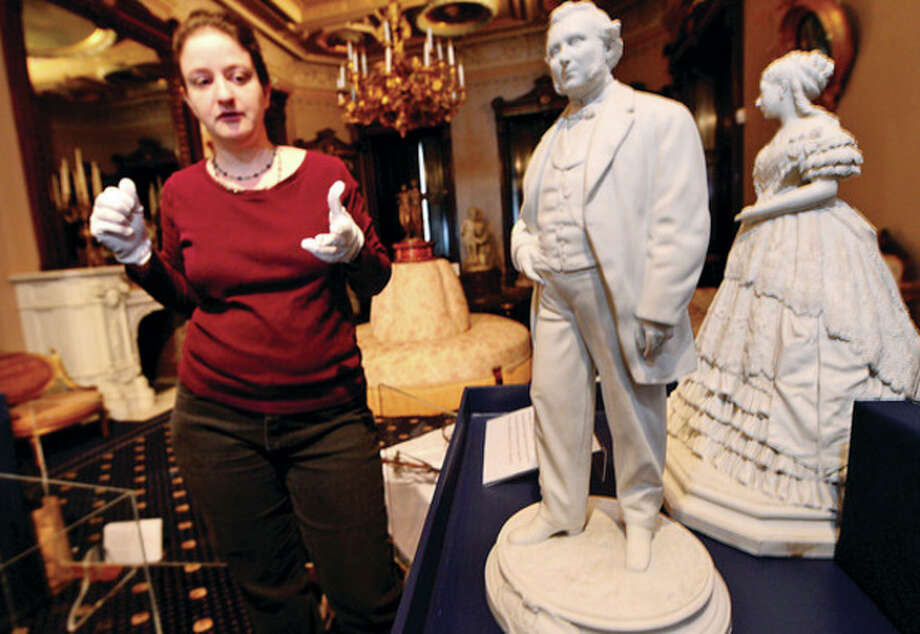 What Is It? Technologies and Discoveries of the Victorian Era exhibit curator Raechel Guest describes a photosculp[yure of Legrand and Ann Louisa Lockwood the will be on display in the upcoming exhibit at the Lockwood Mathews Mansion Museum opening April 17th.Hour photo / Erik Trautmann / (C)2013, The Hour Newspapers, all rights reserved