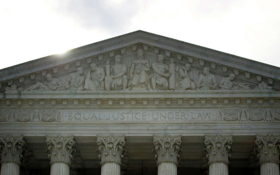 The Supreme Court in Washington, Monday, June 25, 2012. The Supreme Court is meeting Monday to issue opinions in some of the handful of cases that remain unresolved. (AP Photo/Evan Vucci) / AP