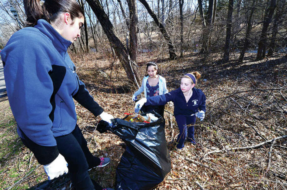 Volunteer and Wilton High School freshman, Michelle Assef, Carly Lovallo and Andrea Prospect help pick up trash at Shenck Island Park as part of The Wilton Conservation Commission's annual Townwide Community Cleanup on Saturday.Hour photo / Erik Trautmann / (C)2013, The Hour Newspapers, all rights reserved