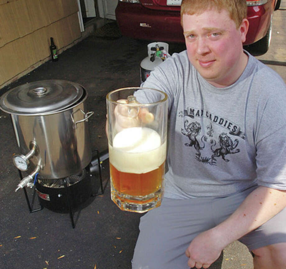 Ken Lafleaur of Stamford is a hobbyist brewer. / (C)2011, The Hour Newspapers, all rights reserved