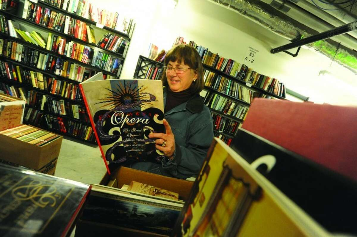 Linda Swanson Sunday at a recent book sale at the Wilton Library. hour photo/Matthew Vinci