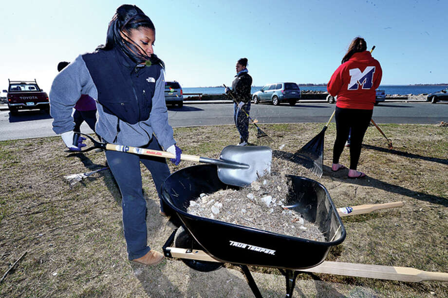 Volunteer and Brien McMahon High School sophmore Nakijah King participates in Keep Norwalk Beautiful Day by helping Clean Up Calf Pasture Beach Saturday. Hour photo / Erik Trautmann / (C)2013, The Hour Newspapers, all rights reserved