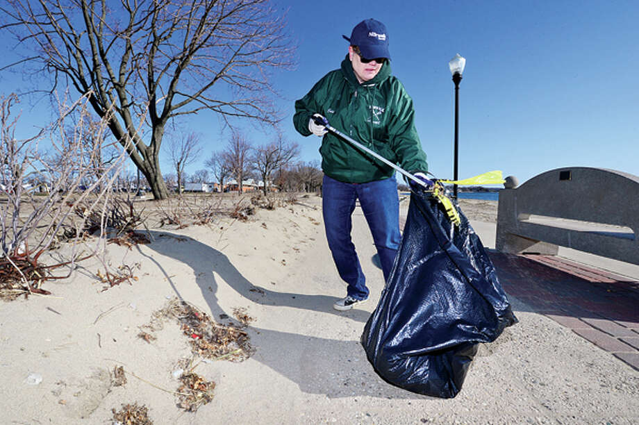 Volunteer Erin Herring participates in Keep Norwalk Beautiful Day by helping Clean Up Palf Pasture Beach Saturday. Hour photo / Erik Trautmann / (C)2013, The Hour Newspapers, all rights reserved