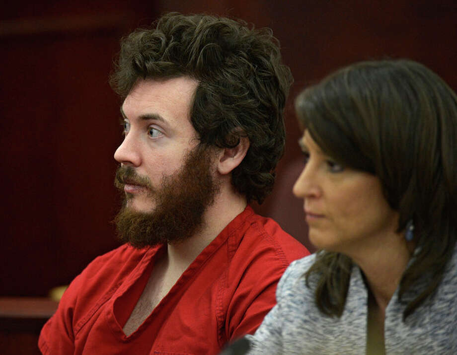FILE - In this March 12, 2013 file photo, James Holmes, left, and defense attorney Tamara Brady appear in district court in Centennial, Colo. for his arraignment. Court documents are raising new questions for the university that Colorado theater shooting suspect James Holmes attended before the July 20 theater shooting that left 12 people dead and 70 injured. (AP Photo/The Denver Post, RJ Sangosti, Pool, File) / Pool Denver Post