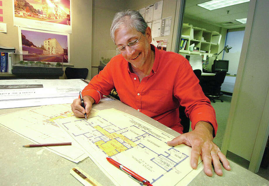 Hour photo / Alex von KleydorffJoseph Vallone goes over some drawings in his Westport office, Joseph Vallone Architects & Development Studio LLC. Vallone is interested in helping to preserve an historic home 14 Charcoal Hill Road slated for demolition. / 2012 The Hour Newspapers