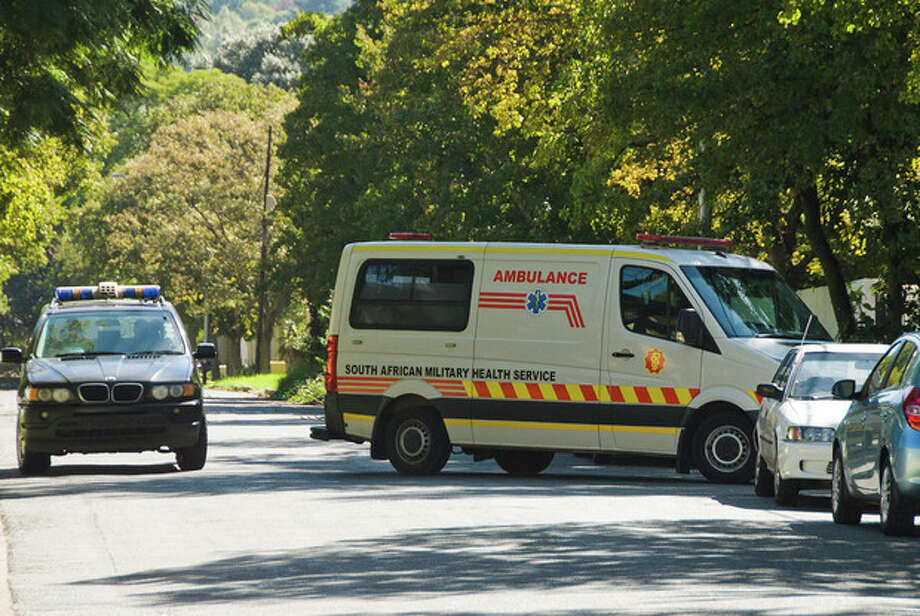 """An ambulance believed to be transporting former president Nelson Mandela arrives at the home of Mandela in Johannesburg, Saturday, April 6, 2013. The South African Presidency has confirmed that Mandela has been discharged after spending nine days in hospital in Pretoria. Spokesman Mac Maharaj says the elder statesman was discharged, """"following a sustained and gradual improvement in his general condition,"""" and thanked all South Africans and people around the world for their support. He says Mandela will now receive home based high care. Mandela was admitted to hospital on March 27 with pneumonia. Since then the 94-year-old former statesman has had fluid drained from his lungs to ease his breathing. (AP Photo) / AP"""