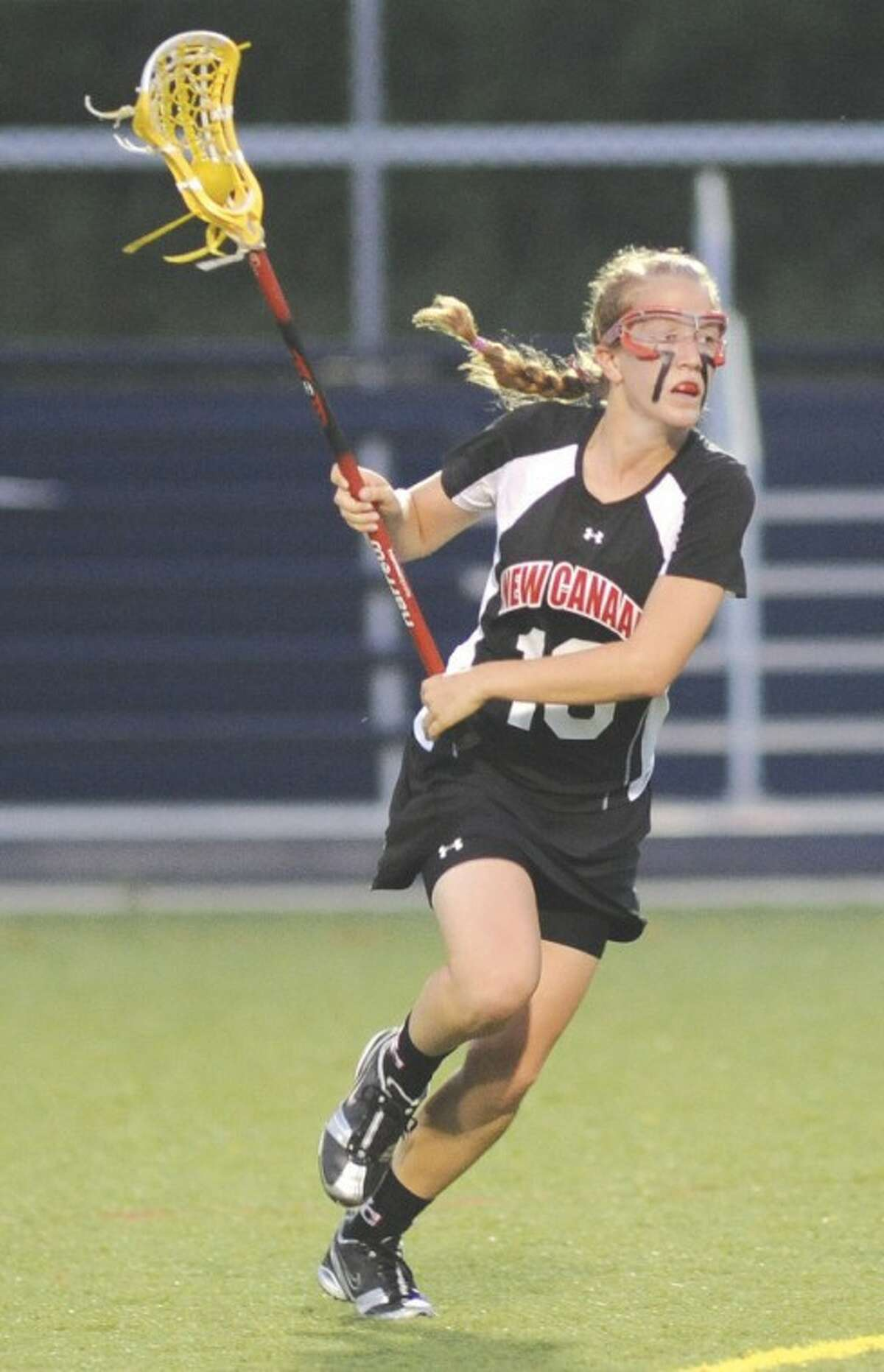 Hour photo/John Nash Sarah Mannelly of New Canaan scored 82 goals and set up 47 others this season. But she is also a stalwart defender, a two-time All-American, Connecticut's player of the year, and The Hour's All-Area girls lacrosse MVP