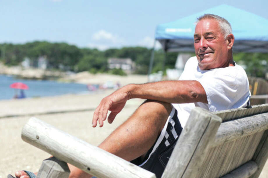 Hour photo/Chris PalmeroDon Wilson, the former longtime McMahon tennis coach and a man who played a plethora of sports along the way, relaxes at Rowayton's Bayley Beach, where he also serves as the director during the summer months. / ©2012 The Hour Newspapers All Rights Reserved.