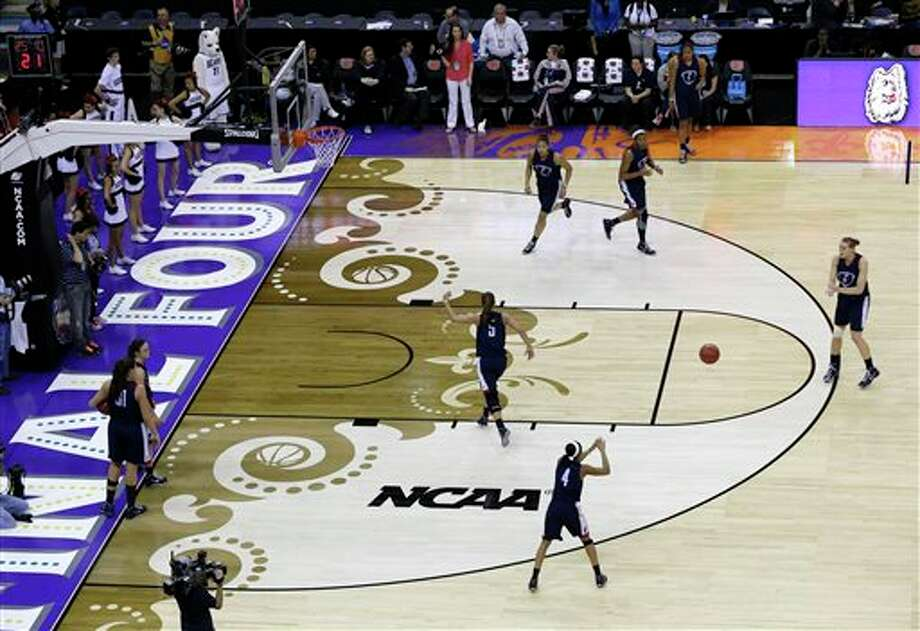 Connecticut players warm up during practice at the Women's Final Four of the NCAA college basketball tournament, Saturday, April 6, 2013, in New Orleans. UConn plays Notre Dame in a semifinal game on Sunday. (AP Photo/Dave Martin) / AP