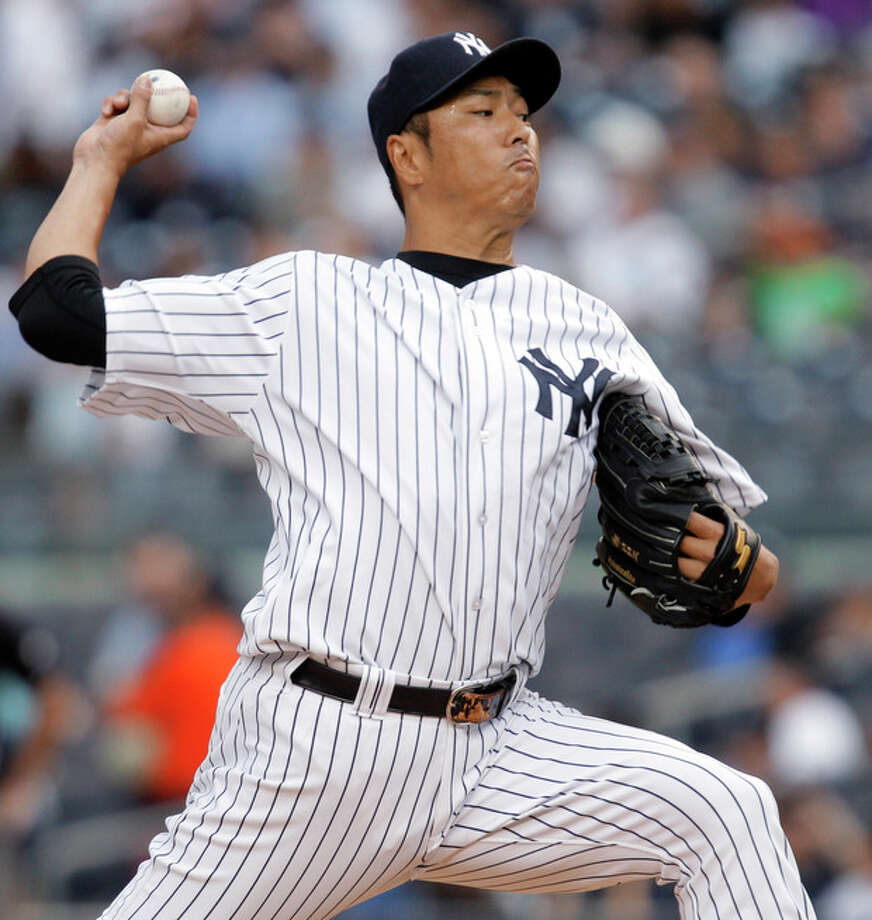 New York Yankees starting pitcher Hiroki Kuroda delivers in the first inning against the Cleveland Indians during a baseball game at Yankee Stadium in New York, Monday, June 25, 2012. (AP Photo/Kathy Willens) / AP