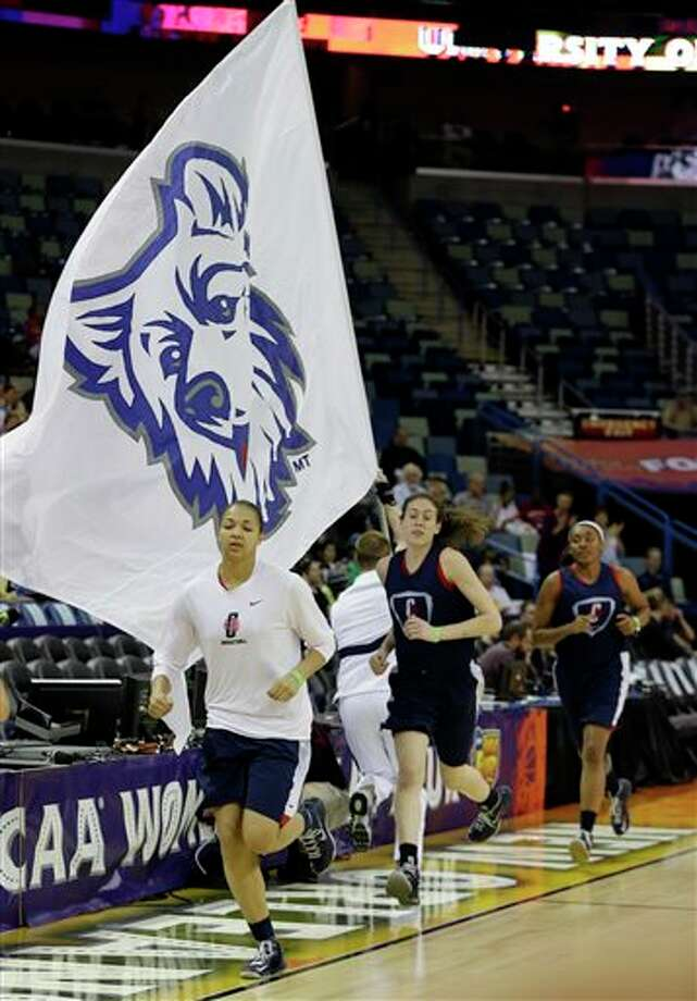Connecticut's Kiah Stokes, Breanna Stewart and Moriah Jefferson jog on to the court for practice at the Women's Final Four of the NCAA college basketball tournament, Saturday, April 6, 2013, in New Orleans. UConn plays Notre Dame in a national semifinal on Sunday. (AP Photo/Dave Martin) / AP