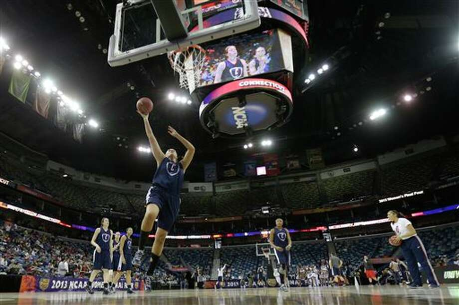 Connecticut center Stefanie Dolson shoots the ball during practice at the Women's Final Four of the NCAA college basketball tournament, Saturday, April 6, 2013, in New Orleans. UConn plays Notre Dame in a semifinal game on Sunday. (AP Photo/Gerald Herbert) / AP