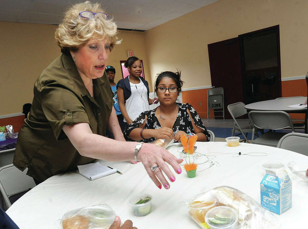 Joann Stabler, director of child care at NEON with Jasmine Shohan 13 on Tuesday at NEON where children from ages 1-18 had free lunch. hour photo/Matthew Vinci