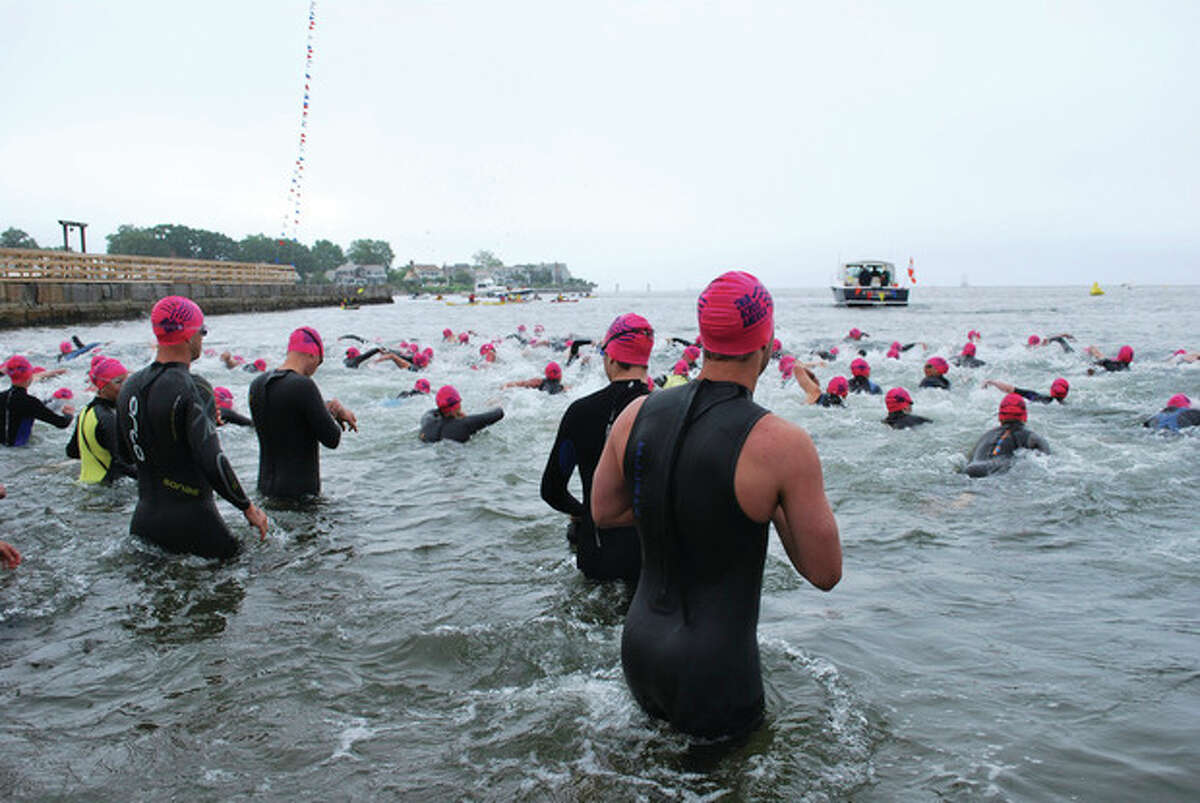 Swimmers launch from the shore at last year's Swim Across America Greenwich-Stamford swim.