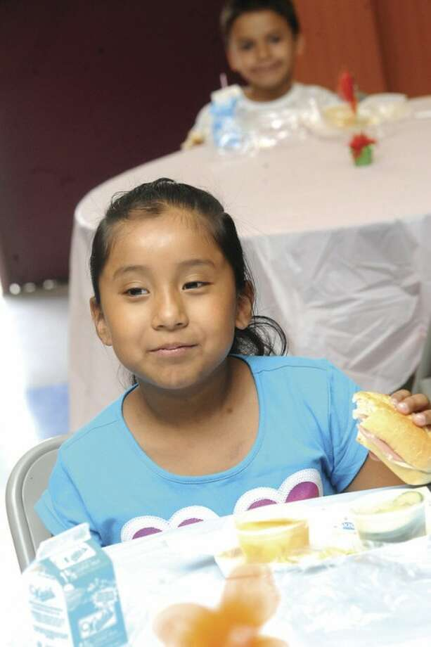 7 year old Ashley Munoz at NEON Tuesday after where children from ages 1-18 ha afree Lunch. hour photo/Matthew Vinci