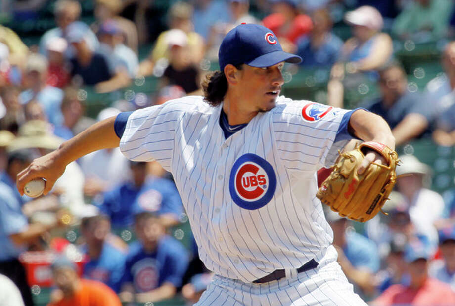 Chicago Cubs starting pitcher Jeff Samardzija delivers during the first inning of a baseball game against the New York Mets, Wednesday, June 27 2012, in Chicago. (AP Photo/Charles Rex Arbogast) / AP