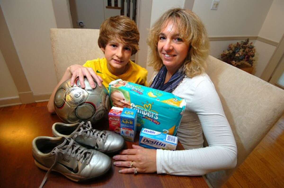 Photo/Alex von Kleydorff. Jill and Eric Pelletier and some of the items they will donate to children in need on their trip to the Bistrita region of Romania