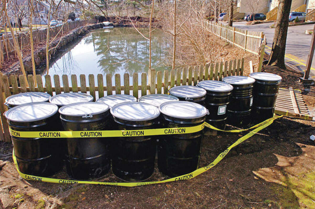 Fuel oil was recovered from waterways in and around the Sunrise Condominiums on Aiken St. earler this year following a fuel leak from West Rocks School. Hour photo / Erik Trautmann