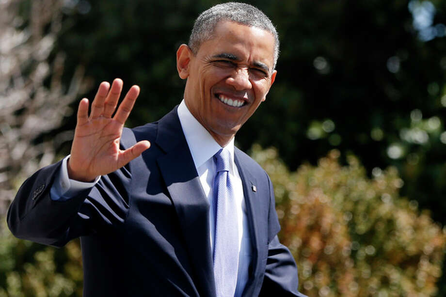 President Barack Obama waves as he walks to board the Marine One helicopter on the South Lawn at the White House in Washington, Wednesday, April 3, 2013, as he travels to Denver and San Francisco. (AP Photo/Charles Dharapak) / AP
