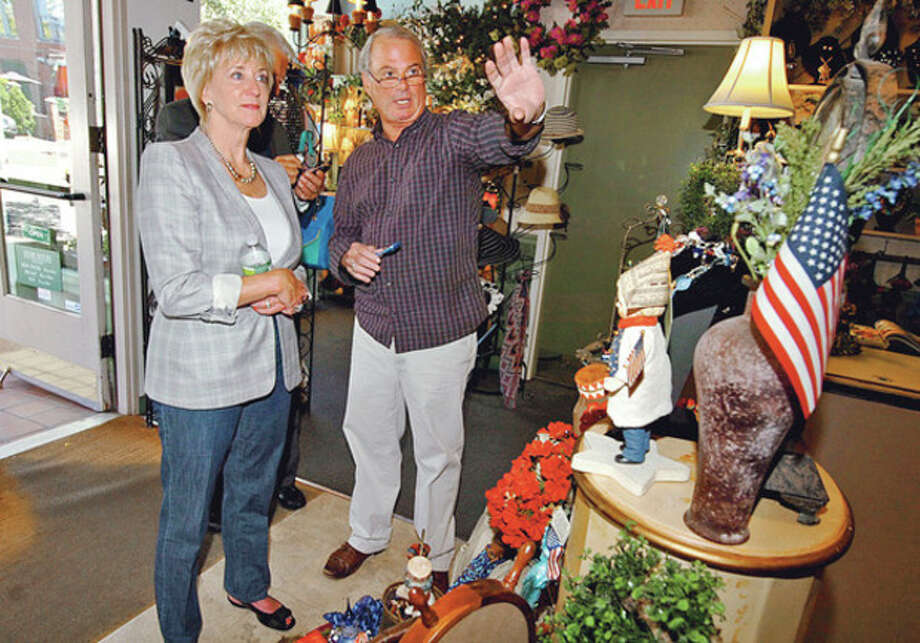 GOP congressional candidate Linda McMahon tours South Norwalk Wednesday including Sassafras where she chats with store owner, John Deorio.Hour photo / Erik Trautmann / (C)2012, The Hour Newspapers, all rights reserved