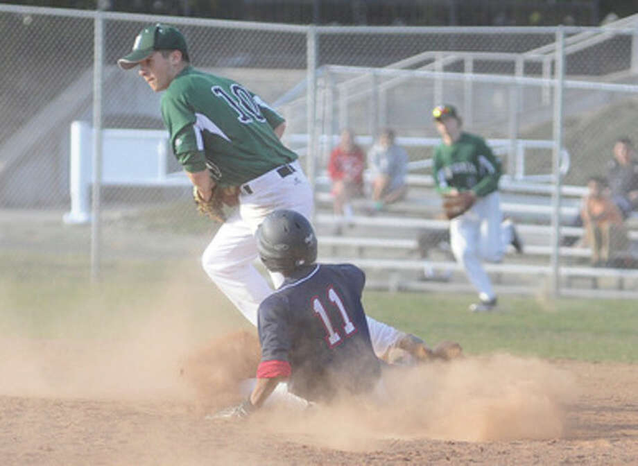 Hour photo/Matthew VinciNorwalk second baseman Dave Balunek, top, tags the bag to force Edwin Owolo of Brien McMahon at second during Monday's clash of the crosstown rivals at the BMHS diamond. The visiting Bears held on for a 5-4 victory.
