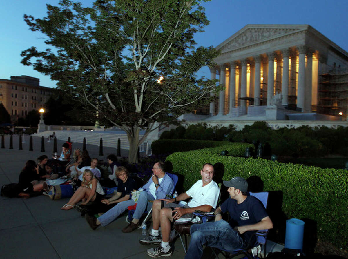 People line up in front of the U.S. Supreme Court on the eve of Thursday's expected ruling on whether or not the Affordable Care Act passes the test of constitutionality Wednesday, June 27, 2012 in Washington. (AP Photo/Alex Brandon)