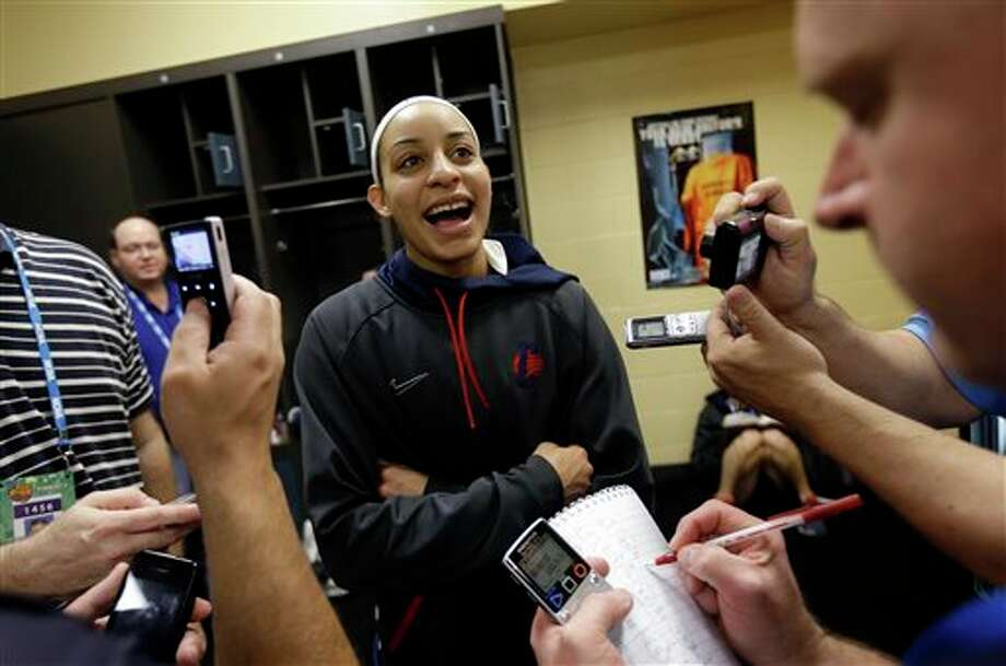 Connecticut guard Bria Hartley talks to reporters in the locker room before practice for the women's NCAA Final Four college basketball tournament final, Monday, April 8, 2013, in New Orleans. UConn plays Louisville in the championship game on Tuesday. (AP Photo/Gerald Herbert) / AP