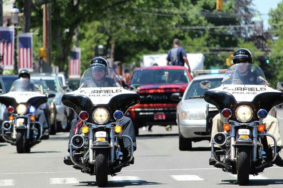 Police motorcycles escort the Law Enforcement Torch Run for Special Olympics into Fairfield Friday, where the runners took a lunch break at the Sherman Green. Photo: Genevieve Reilly / Hearst Connecticut Media / Fairfield Citizen