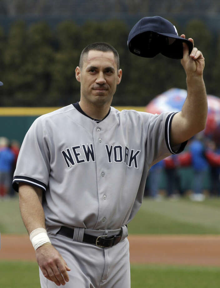 New York Yankees' Travis Hafner waves to fans as he is introduced before the Yankees play the Cleveland Indians in a home opener baseball game, Monday, April 8, 2013, in Cleveland. (AP Photo/Mark Duncan)