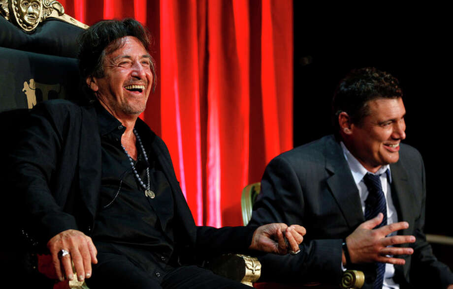 """AP photo / Matt Sayles Al Pacino, left, and Steven Bauer speak onstage during the """"Scarface"""" Legacy Celebration Eventon Tuesday in Los Angeles. """"Scarface"""" will be released on Blu-ray Sept. 6. / AP2011"""