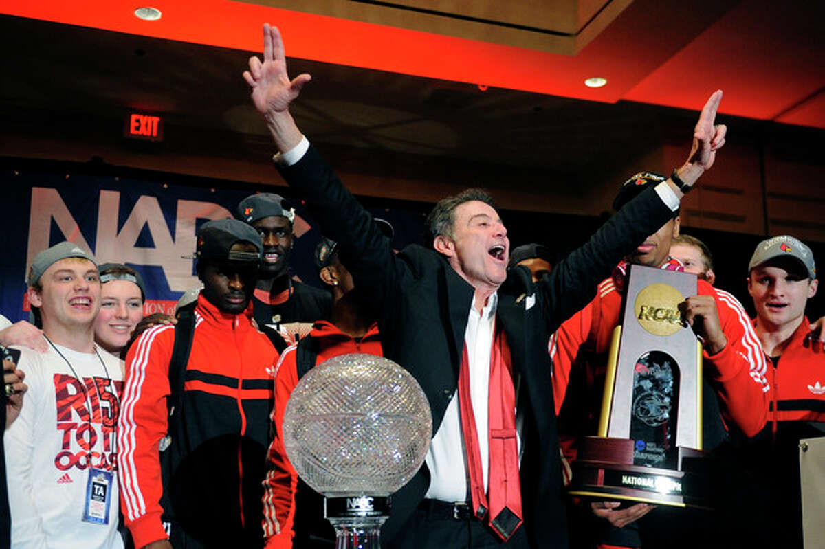 Louisville coach Rick Pitino and team greet fans at the the trophy ceremony after winning the NCAA Final Four tournament college basketball championship game against Michigan, Monday, April 8, 2013, in Atlanta. Louisville won 82-76. (AP Photo/John Amis)