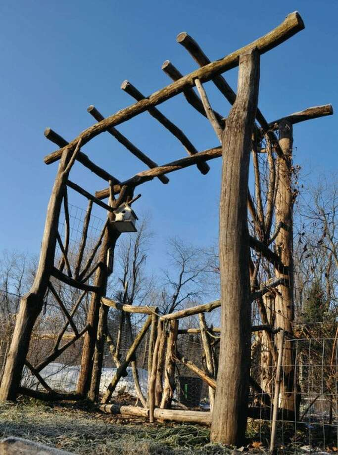 This undated photo courtesy of Lee Reich shows an arbor built of locust, a tree whose wood is very rot resistant, in New Paltz, N.Y. (AP Photo/Lee Reich) NO SALES