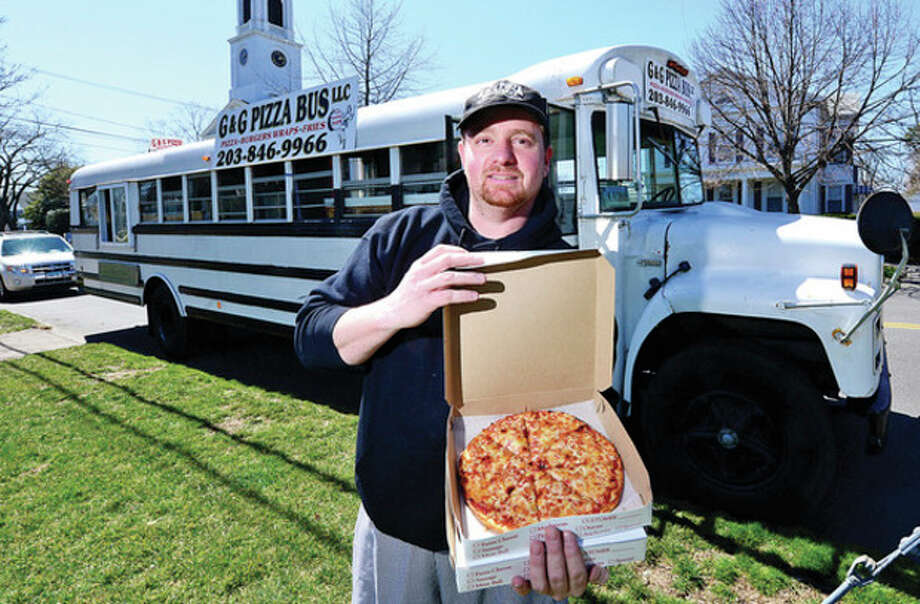 Hour photo / Erik TrautmannNorwalk native and longtime pizza chef Nick Hios has opened the G&G Pizza Bus offering pan pizza and other items. / (C)2013, The Hour Newspapers, all rights reserved