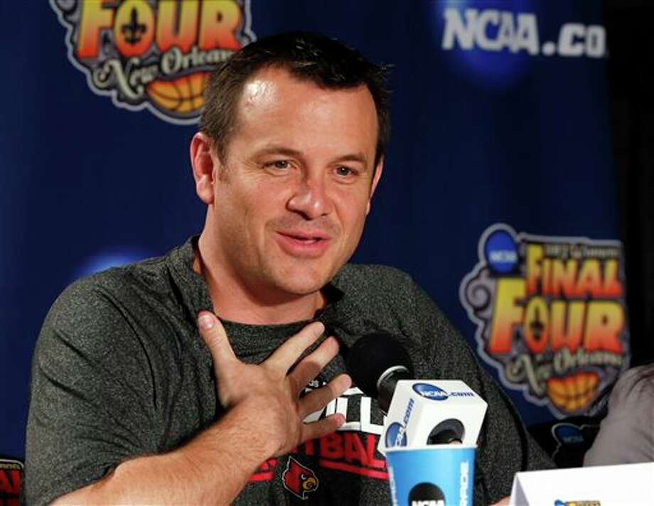 Louisville head coach Jeff Walz reacts during a news conference for the women's NCAA Final Four college basketball tournament final, Monday, April 8, 2013, in New Orleans. Louisville plays Connecticut in the championship game on Tuesday. (AP Photo/Dave Martin) / AP