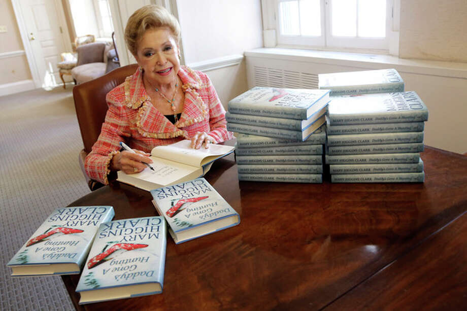 AP Photo/Mary AltafferIn this Wednesday, April 3 photo, author Mary Higgins Clark sign copies of her latest book. / AP