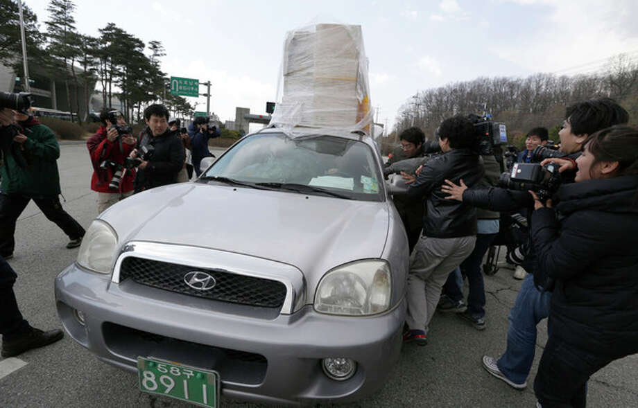 A South Korean vehicle with products from North Korea's Kaesong is surrounded by media upon its arrival at the customs, immigration and quarantine office near the border village of Panmunjom, which has separated the two Koreas since the Korean War, in Paju, north of Seoul, South Korea, Tuesday, April 9, 2013. North Korean workers didn't show up for work at a jointly run factory complex with South Korea on Tuesday, a day after Pyongyang suspended operations at the last remaining major economic link between rivals locked in an increasingly hostile relationship. (AP Photo/Lee Jin-man) / AP