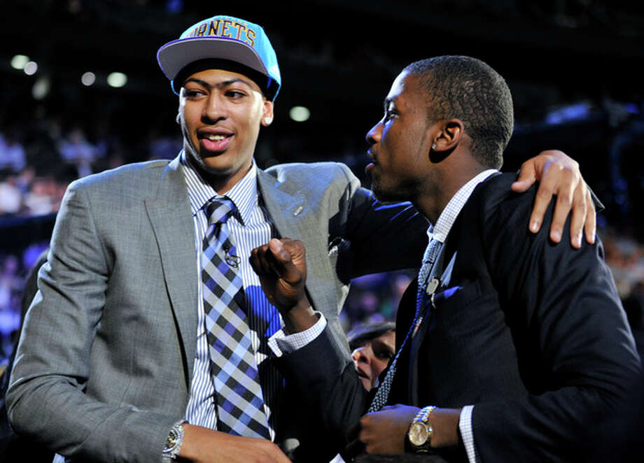Kentucky's Anthony Davis, left, is congratulated by former teammate Michael Kidd-Gilchrist, right, after Davis was selected the No. 1 overall draft pick by the New Orleans Hornets in the NBA basketball draft, Thursday, June, 28, 2012, in Newark, N.J. Kidd-Gilchrist was selected No. 2 overall by the Charlotte Bobcats. (AP Photo/Bill Kostroun) / FR51951 AP