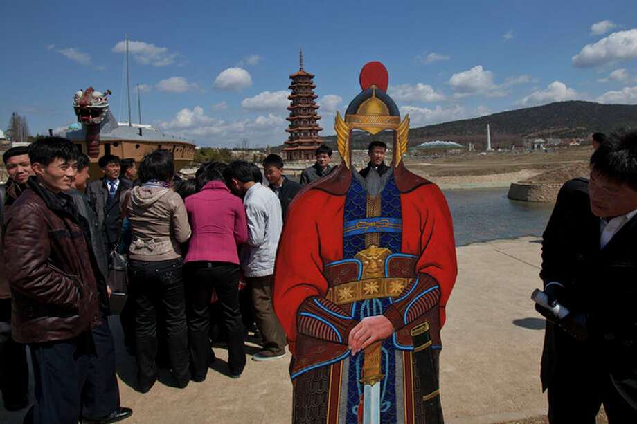 North Koreans visit the Pyongyang Folk Park on the outskirts of Pyongyang Thursday, April 11, 2013. The park, which spans Korean history from prehistoric to modern times, opened in September 2012 after three years of construction by North Korean soldiers. (AP Photo/David Guttenfelder) / AP