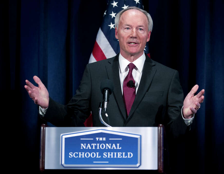 National School Shield Task Force Director, former Arkansas Rep. Asa Hutchinson gestures during a news conference at National Press Club in Washington, Tuesday, April 2, 2013, to discuss his groups's school-guns study. The National Rifle Association's study recommends schools across the nation each train and arm at least one staff member. (AP Photo/Jose Luis Magana) / FR159526 AP