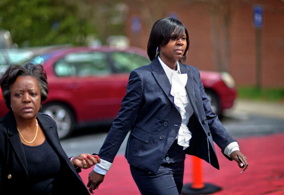 Atlanta Public Schools defendant Sandra Ward, right, turns herself in at the Fulton County Jail accompanied by her attorney Robbin Shipp, left, Tuesday, April 2, 2013, in Atlanta. 35 defendants in Atlanta's school cheating scandal are named in a 65-count indictment that alleges a broad conspiracy involving cheating on standardized tests in Atlanta Public Schools. All 35 defendants must turn themselves in Tuesday. (AP Photo/David Goldman) / AP