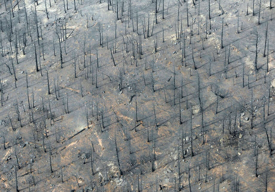 This aerial photo shows the destructive path of the Waldo Canyon fire in the Mountain Shadows subdivision area of Colorado Springs, Colo., Thursday, June 28, 2012. Colorado Springs officials said Thursday that hundreds of homes have been destroyed by the raging wildfire. (AP Photo/Denver Post, RJ Sangosti) / (C) 2012 The Denver Post, MediaNews Group