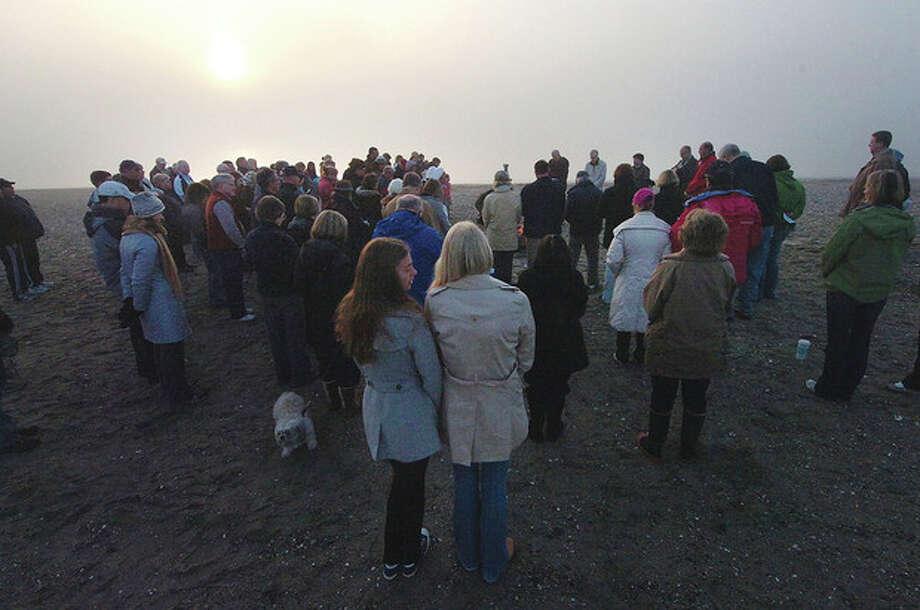 Photo/Alex von Kleydorff. Sunrise Easter Service at Compo Beach on Sunday / © 2011 The Hour Newspapers/Alex von Kleydorff
