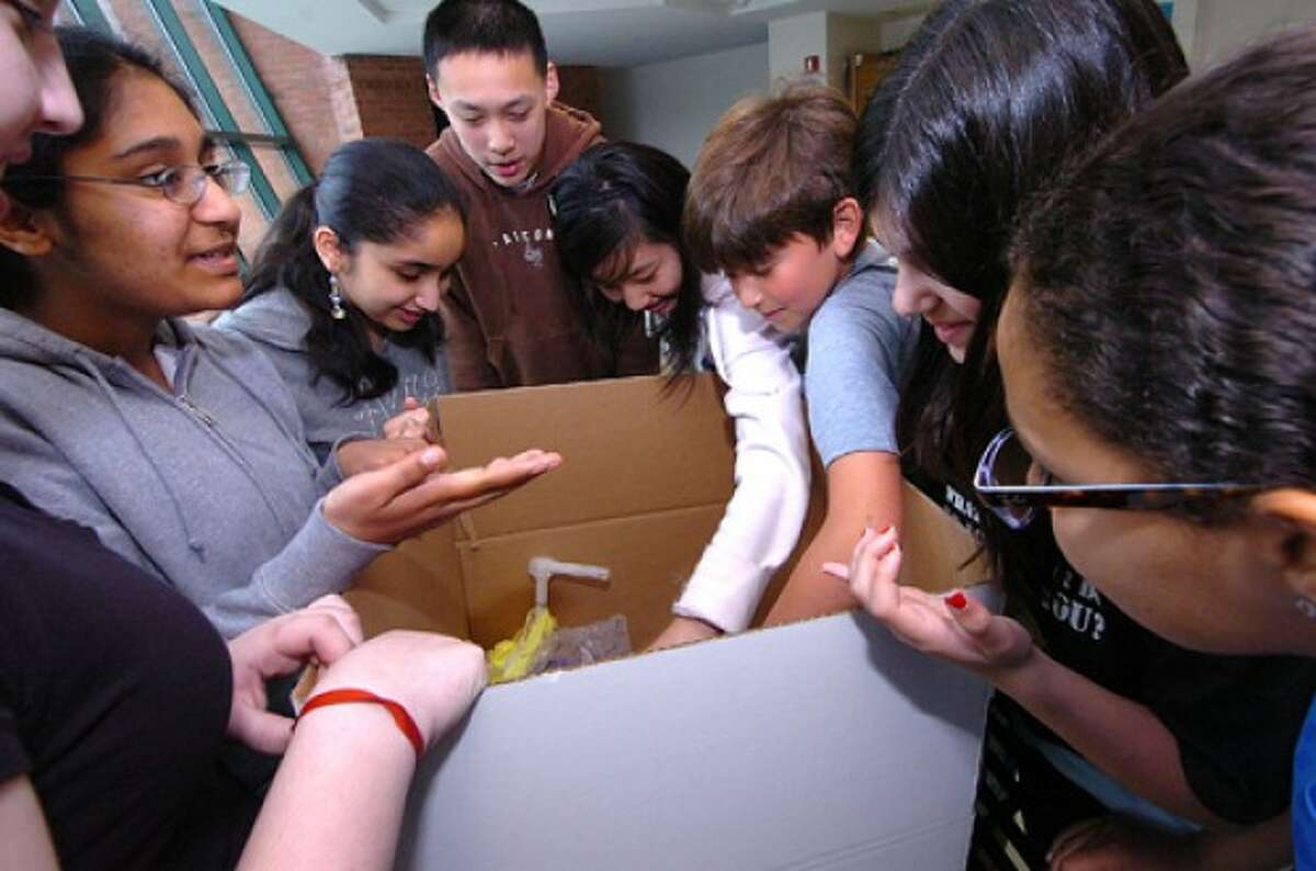 Photo/Alex von Kleydorff. Scofield Magnet School Builders Club students finish packing some of the more than 2000 items they collected for Domestic Violence Crisis Center Safe house in Stamford and Norwalk.
