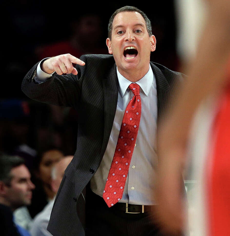 FILE - In this March 12, 2013, file photo, Rutgers coach Mike Rice yells out to his team during an NCAA college basketball game against DePaul at the Big East tournament in New York. Rutgers said it would reconsider its decision to retain Rice after a videotape aired showing him shoving, grabbing and throwing balls at players in practice and using gay slurs. The videotape, broadcast Tuesday, April 2, on ESPN, prompted scores of outraged social media comments as well as sharp criticism from Gov. Chris Christie and NBA star LeBron James. (AP Photo/Frank Franklin II, File) / AP