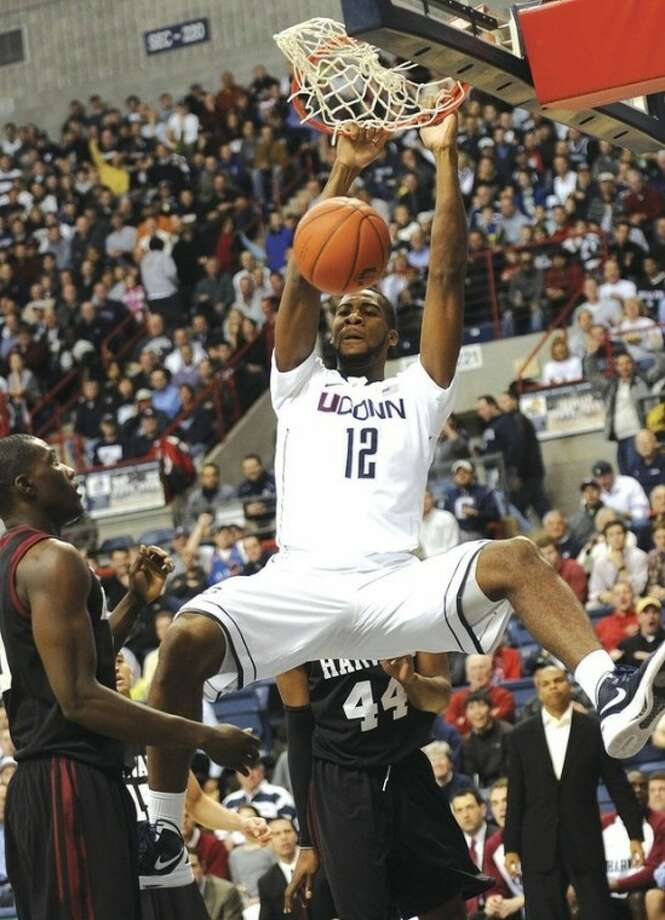 AP photo UConn's Andre Drummond dunks in front of Harvard's Keith Wright (44) during the first half of Thursday night's game. Drummond had 12 points in the Huskies' 67-53 victory over a Harvard squad that is nationally ranked for the first time.